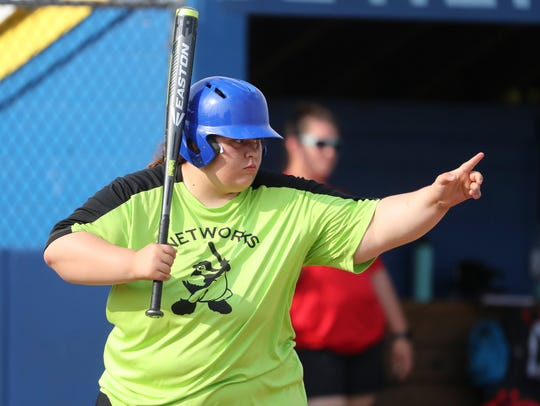 Connie McAllister, playing for the team made up of students from the Networks School for Employability Skills, gets set to hit during the Special Olympics softball competition at the University of Delaware.