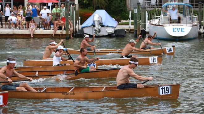 Participants compete during a past Great Dock Canoe Race.