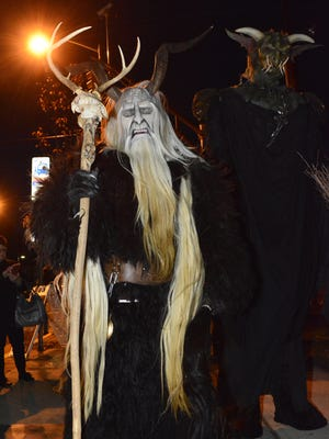 Paranormal Books and Curiosities on Cookman Avenue in Asbury Park hosted the 2016 Krampus Festival. Krampus are shown on Cookman Avenue in Asbury Park.