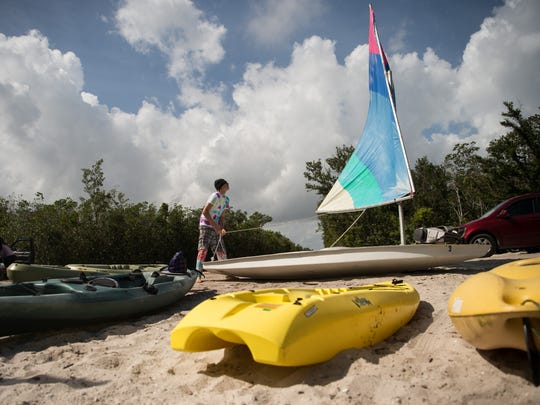 Nicolas Davidson, 16, of Vero Beach, prepares to sail