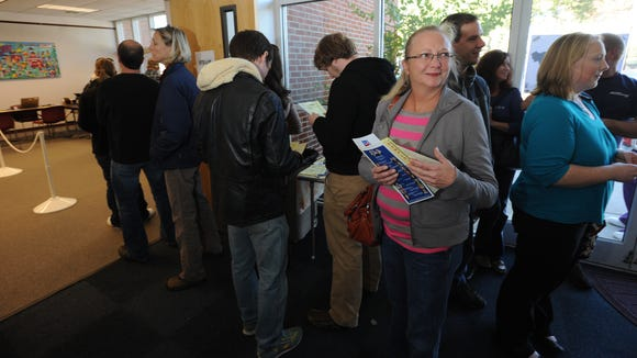 Voters wait in line for early voting at the West Asheville Library in 2012.