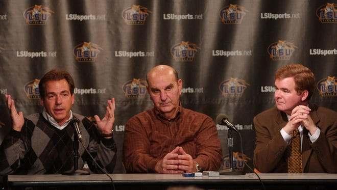 Nick Saban, (left) then the head football coach at LSU, is pictured with former athletic director Skip Bertman (center), and then-LSU chancellor Mark Emmert in this photo from 2003 to announce Saban's team would play Oklahoma in the Sugar Bowl for the BCS championship.