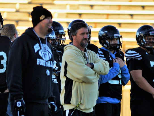 Big Spring coach Mitch McLemore (center) conducts practice