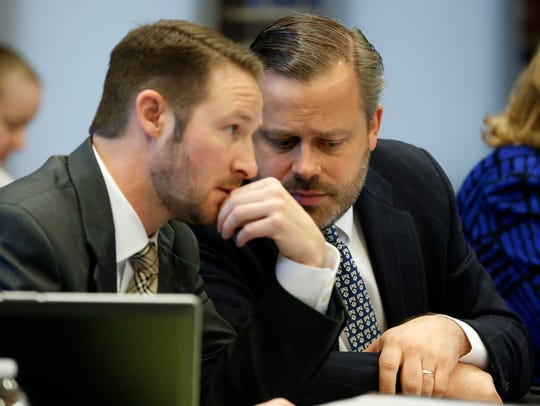 WellCare attorney Robert Highsmith, Jr., (right) confers