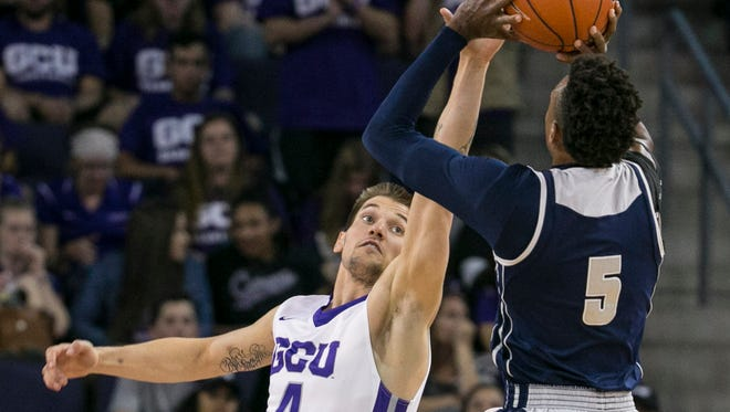 GCU's Ryan Majerle (4) jumps up to contest a shot from JSU's Paris Collins (5) in the first half at GCU in Phoenix, Ariz. on Thursday, March 17, 2016.