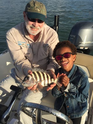 Leighton with one of her many sheepshead of the day.