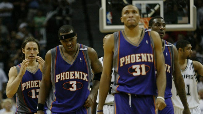 Phoenix Suns' Steve Nash, left, Quentin Richardson, second from left, Shawn Marion, and Amare Stoudemire, right, walk off the floor after game 3 of the Western conference finals loss to the San Antonio Spurs in San Antonio, Saturday, May 28, 2005. San Antonio won 102-92.