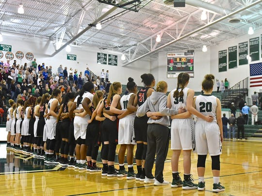 Lakota West and Mason athletes come together for the National Anthem is a display of unity between the two schools Saturday, February 10th at Mason