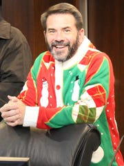 City Councilman Kyle McAlister wore a Christmas sweater that even Councilman Steve Savage would say stinks.
