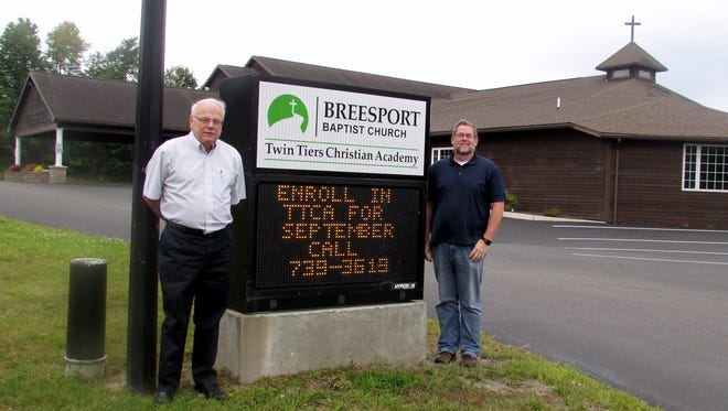 Senior pastor Doug Forman, right, and associate pastor Mike Harris lead the congregation at Breesport Baptist Church, which will celebrate its 150th anniversary this month.