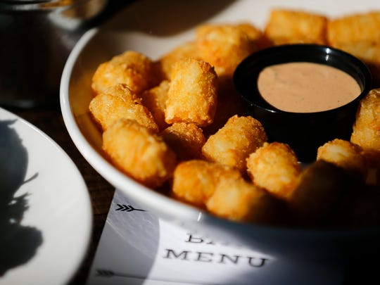 An order of tatertots at Revolution Rotisserie & Bar in the Pleasant Ridge neighborhood of Cincinnati on Friday, March 9, 2018.