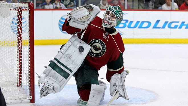 Minnesota Wild goalie Josh Harding (37) makes an overtime save in a 3-2 win against the Vancouver Canucks.