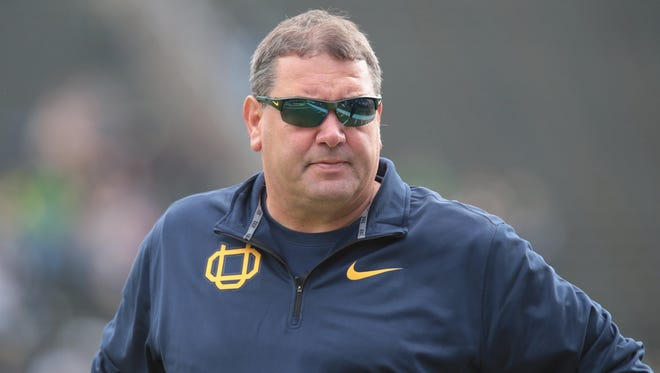 Oregon defensive coordinator Brady Hoke watches from the sideline April 30, 2016.