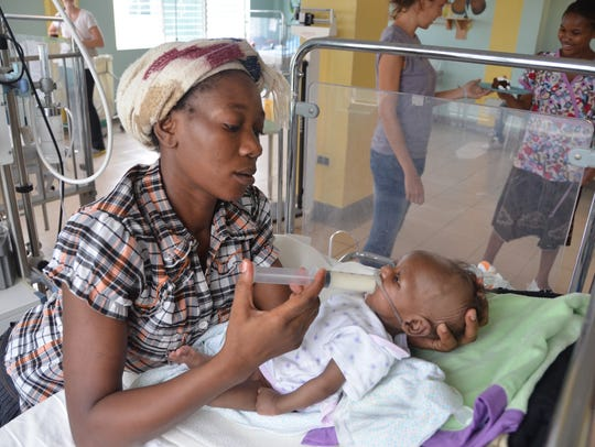 A child is treated in a St. Luke's facility in Haiti.