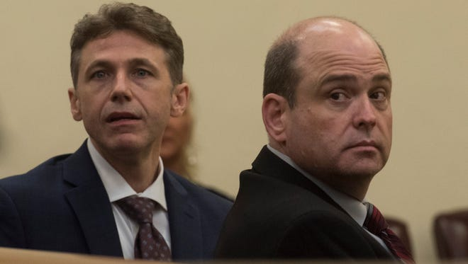 Charles McMullen, a former supervisor with the Florida Department of Law Enforcement, right, and his attorney look back at witnesses during court on Monday.