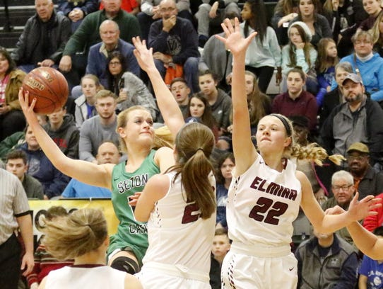Ava McCann of Seton Catholic Central goes up for a