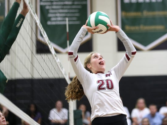 Chiles' Kelsey Mead sets the ball against Lincoln during