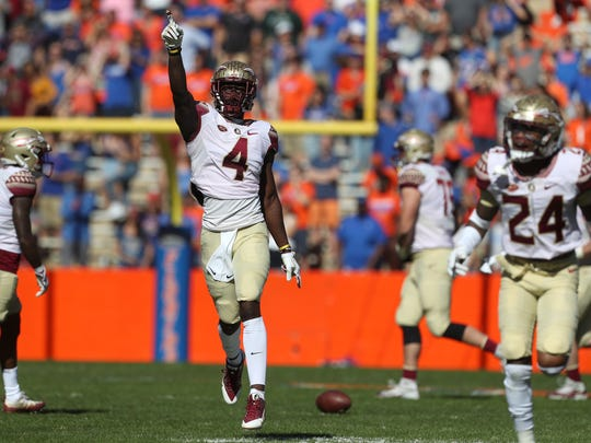 FSU's Tarvarus McFadden celebrates a pass deflection against Florida during the Seminoles 38-22 win at Ben Hill Griffin Stadium in Gainesville on Saturday.