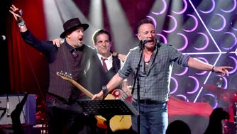 (L-R) Danny Clinch and Chris Scianni of the Tangiers Blues Band perform onstage with Bruce Springsteen during the Grand Re-Opening of Asbury Lanes at Asbury Lanes on June 18, 2018 in Asbury Park, New Jersey.