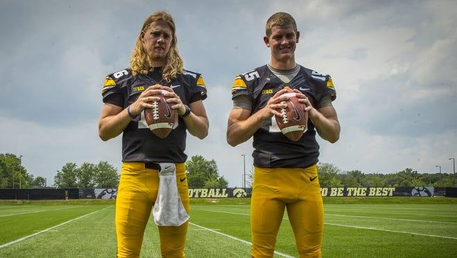 Iowa quarterbacks C.J. Beathard, left, and Jake Rudock pose during the football team's media day Aug. 4.