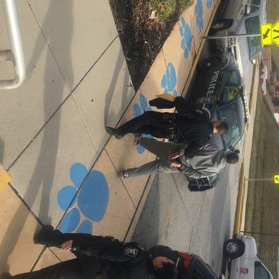 West York Borough Police escort Shaun Schantz outside