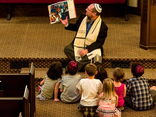 Rabbi Kaufman delivers the children's sermon during the Shabbat service at Temple B'nai Jeshurun.