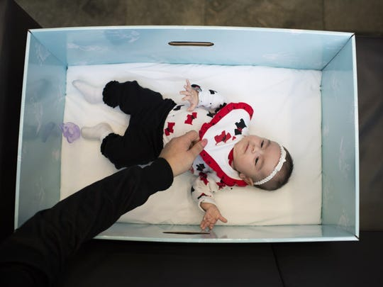 """The """"baby boxes"""" are being given free of charge to"""