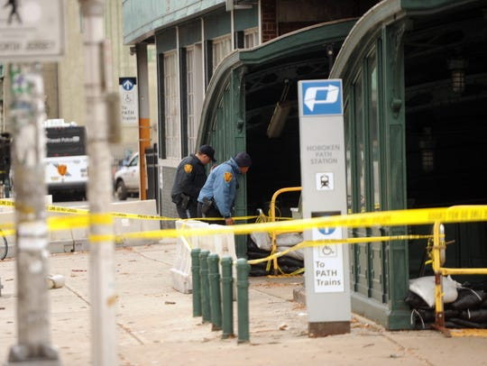 NJ Transit Police take a peek into the entrance stairs to the Hoboken Path station after Superstorm Sandy flooded the town and station.