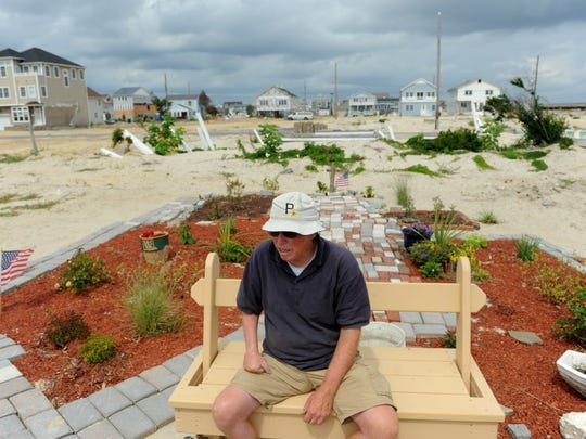 Bill Mullen, shown here in August 2013, lost his Ortley Beach home during Sandy and returns everyday to tend to a makeshift garden on the empty lot.