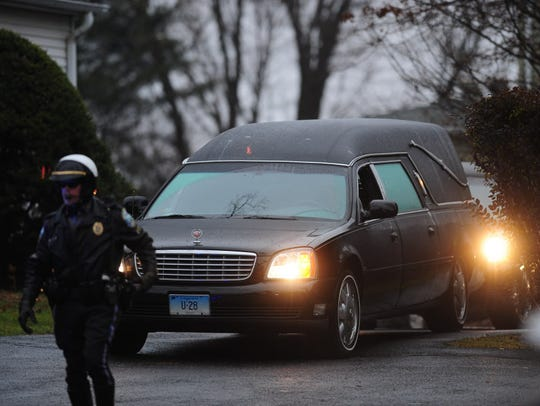 The hearse carrying the body of Jack Pinto, 6, killed