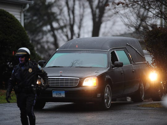 The hearse carrying the body of Jack Pinto, 6, killed in the mass shooting at Sandy Hook Elementary, leaves the funeral home in Newton.