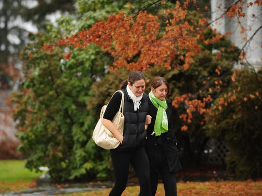 Two unidentified woman weep as they exit Honan Funeral Home in Newtown, after attending the wake for Jack Pinto, 6, killed in the mass shooting at Sandy Hook Elementary.