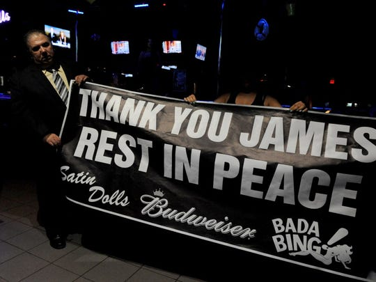 "Billy Pepe, a spokesman for Satin Dolls, where ""The Sopranos"" filmed episodes, held up a farewell banner in memory of James Gandolfini on June 20, 2013."