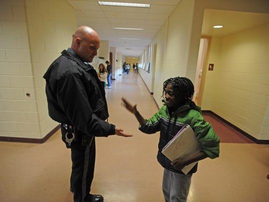 Totowa Police Officer Pontenzone, greets student Schneider