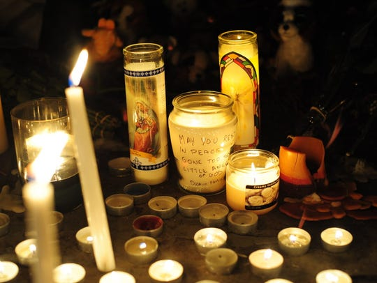 A makeshift candle light memorial at Saint Rose of