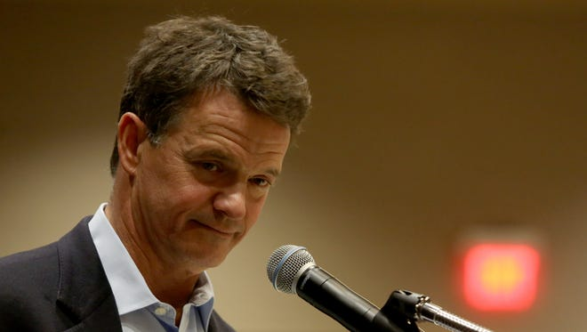 U.S. Representative Dave Trott listens to a question during a public town hall meeting on March 18, 2017 at the Suburban Collection Showplace in Novi.