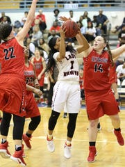 South Side's Quanardra Miller goes up for a shot while being surrounded by Lexington defenders on Monday.