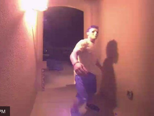 A masked person rings a doorbell at a Sonoma Ranch