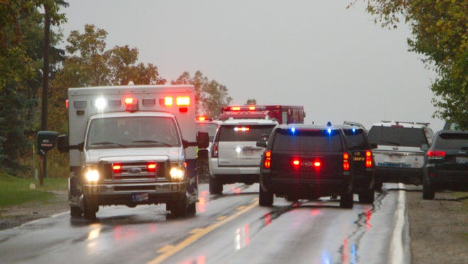 A Livingston County EMS ambulance pulls away from the scene of a vehicle crash on Mason Road west of Kern on the border of Iosco and Handy townships Friday, Oct. 6, 2017.