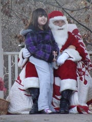 Children can sit with Santa and have their photo taken