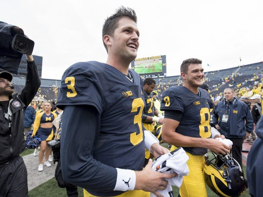 """Quarterback Wilton Speight, left, is battling to maintain his starting role for Michigan this season, while John O'Korn said he's """"ready if my number is called."""""""