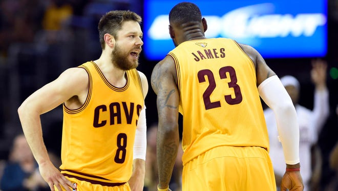 Cavaliers guard Matthew Dellavedova (8) talks with forward LeBron James during the first quarter against the Golden State Warriors in Game 3 of the NBA Finals Tuesday.