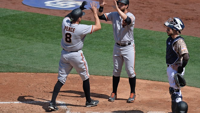 The San Francisco Giants' Brandon Belt congratulates Hunter Pence (8) after Pence drove him in with a two-run home run.