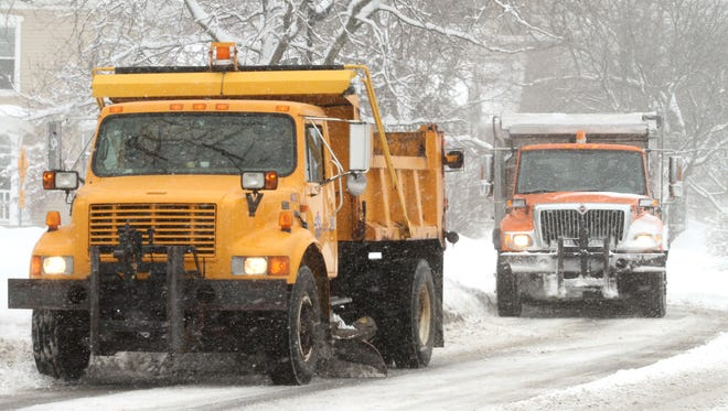 Brighton DPW plow trucks clear area roads surrounding Main Street in downtown Brighton in this undated file photo.
