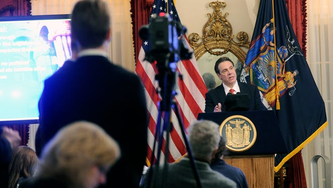 New York Gov. Andrew Cuomo releases his proposed state budget during a news conference at the Executive Mansion in Albany, N.Y.,Tuesday, Jan. 17, 2017.