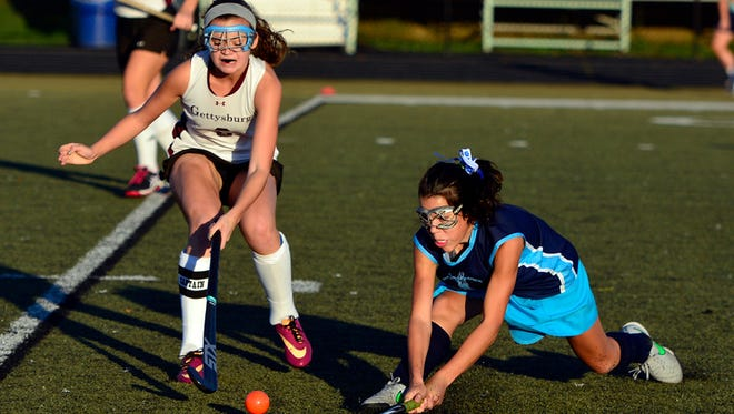 Dallastown's Molly Lohss, right, hits the ball around Gettysburg defender Madi Hireisen during a game last season. The Y-A League announced it will expand from three divisions to four beginning this fall.  John A. Pavoncello - jpavoncello@yorkdispatch.com