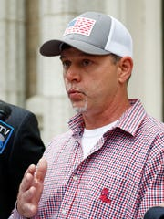 Former convict Dennis Hopkins, 42, says at a news conference