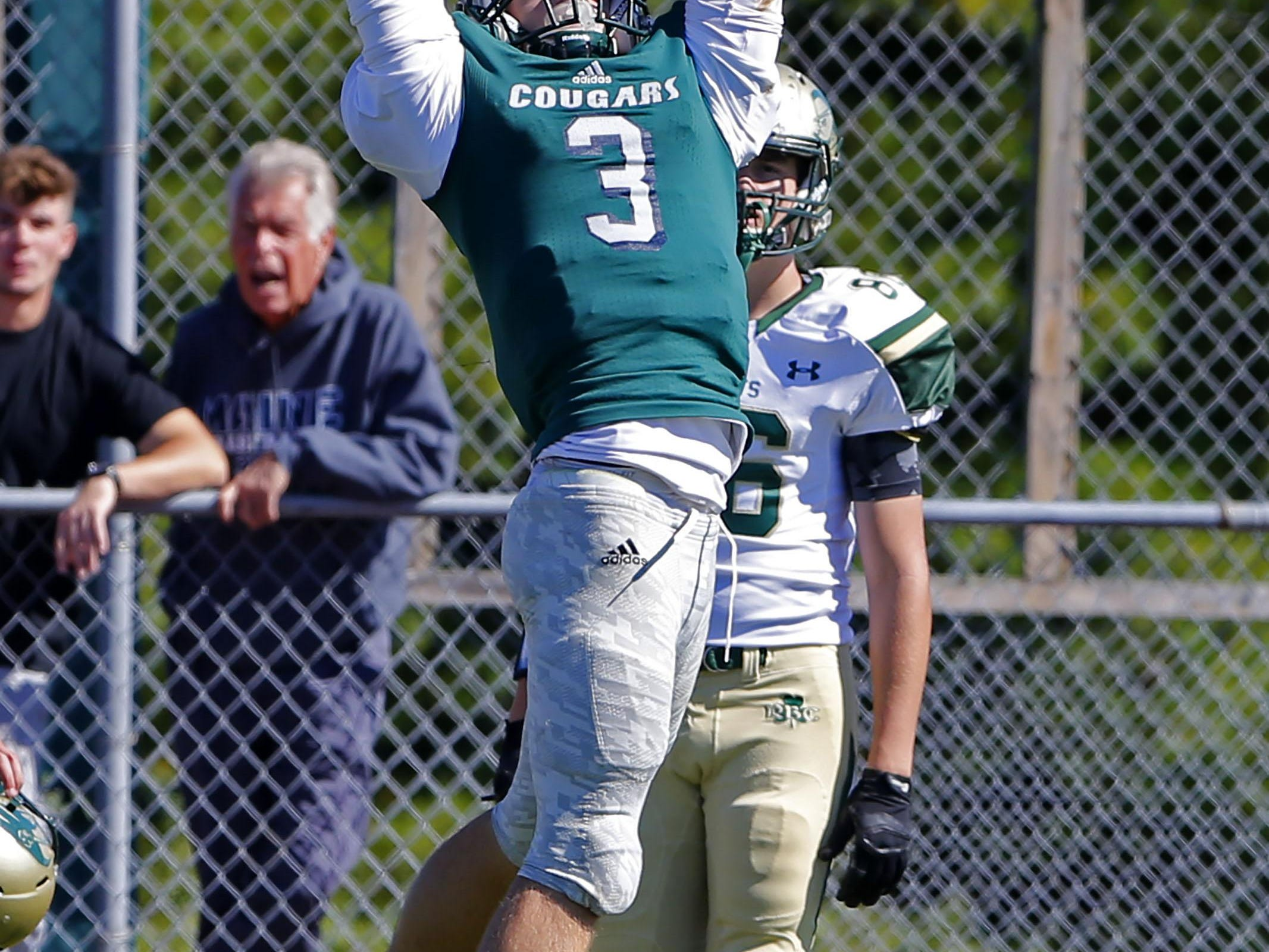 Matt Volk (3) of Colts Neck has the ball go throw his hands during game against Red Bank Catholic at Colts Neck High School, Colts Neck,NJ. Saturday, October 10, 2015. Noah K.