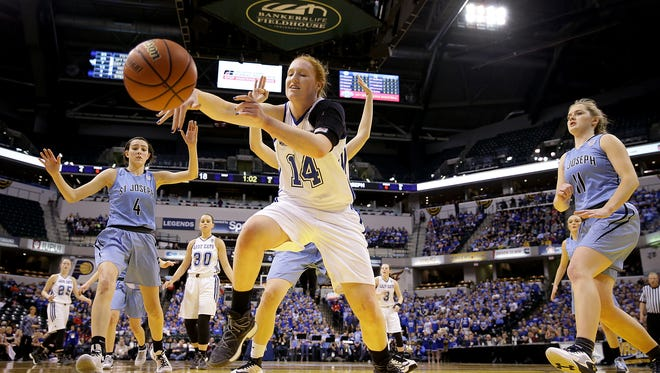 North Harrison Lady Cats Lilly Hatton (14) leaps for the ball before it goes out of bounds in the first half of their IHSAA 3A Girls Basketball State Finals game Saturday, February 25, 2017, evening at Bankers Life Fieldhouse.