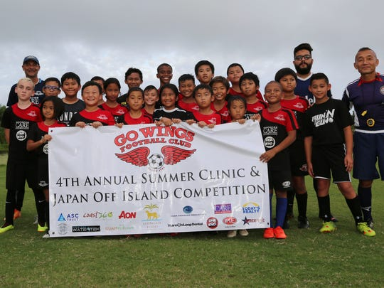 Youth players and coaches gather for a photo after the closing ceremony of the Wings Football Club's 4th annual summer clinic and Japan off-island competition on July 21 at Leo Palace Resort Guam.